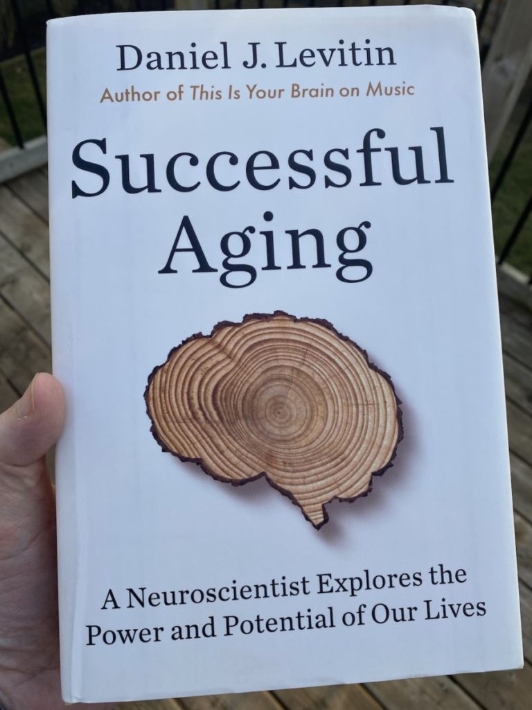 Picture of the book by Daniel J Levitin on Successful Aging, part of the OpencityInc 9 books that made a positive difference in 2020