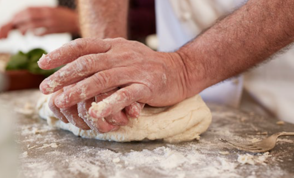 Older person making bread from The Future of Aging book
